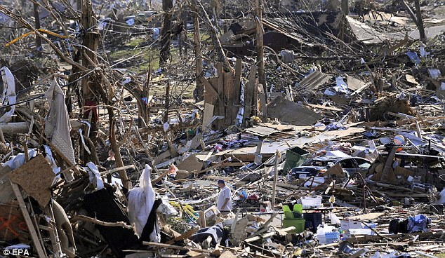Nothing left: A man looks through the remains of a home in Pleasant Grove, Alabama