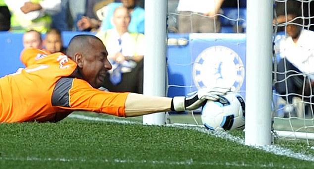 tottenham's gomes prevents the ball from crossing the goal line