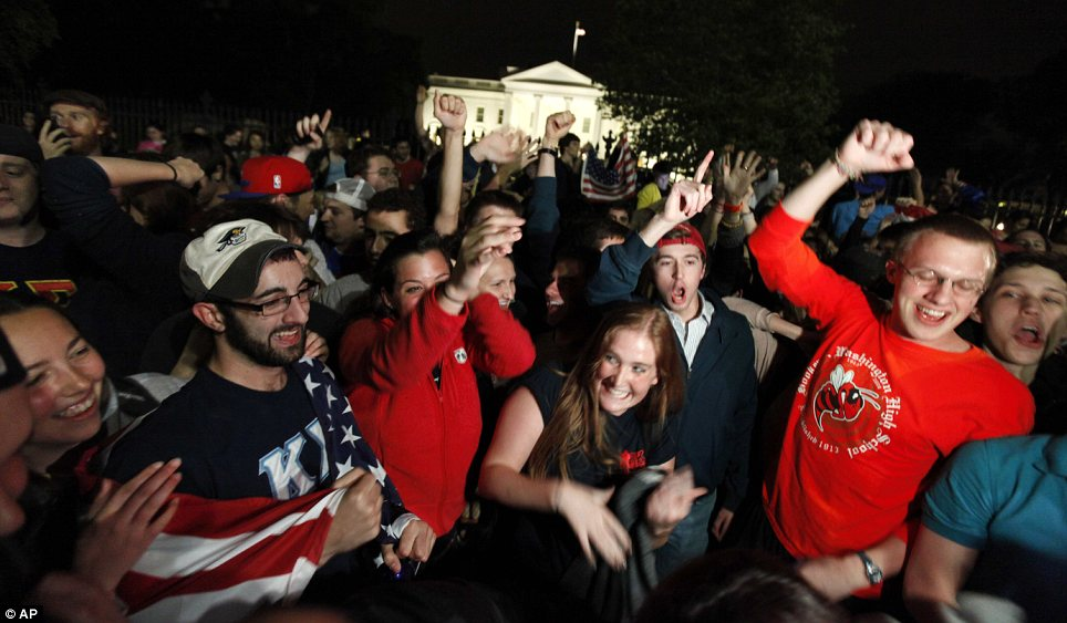 Young people celebrate outside the White House.
