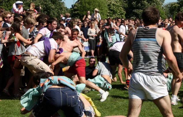 Public park: The Jesus College inter-year drinking society fight with the Girton Green Giants, on Jesus Green in Cambridge on Sunday afternoon