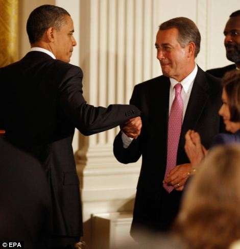Barack Obama is congratulated by the Speaker of the House John Boehner