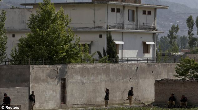 Surrounded: Members of the anti-terrorism squad are seen surrounding the compound where Osama Bin Laden was killed