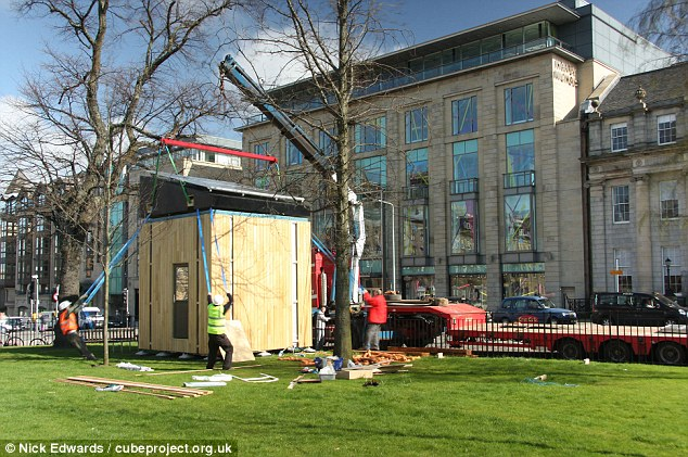 Clever: The Cube, seen being erected, is the brainchild of Dr Mike Page of the University of Hertfordshire