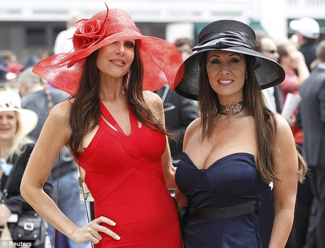Waiting to be noticed: Race fans walk the grounds before the Kentucky Derby in their finery