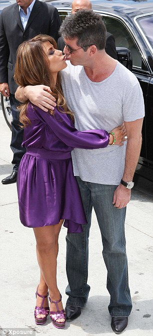 Reunited: Former American Idol judges Simon Cowell and Paula Abdul celebrate their new show with a kiss on the lips