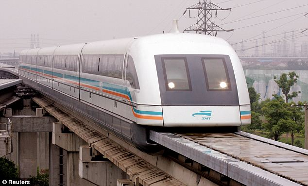 A maglev train - another type of floating train which uses powerful electromagnets to float above the track - passes through Shanghai