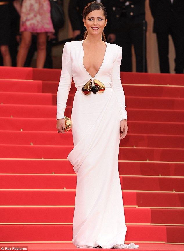 The lady is a vamp: Cheryl Cole turned heads as she arrived at the Habernus Papam premiere during the Cannes Film Festival wearing a plunging white Stephane Rolland dress