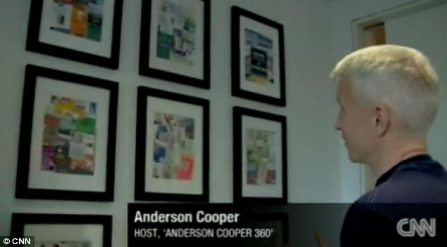 Memory lane: Anderson Cooper shows off his collages of press passes in his CNN office