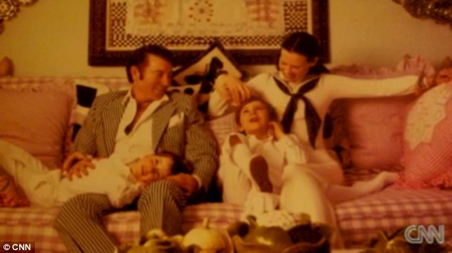 Tragic family: Young Mr Cooper and his heiress mom Gloria Vanderbilt, plus his older brother Carter, who killed himself at age 23 by jumping out a window