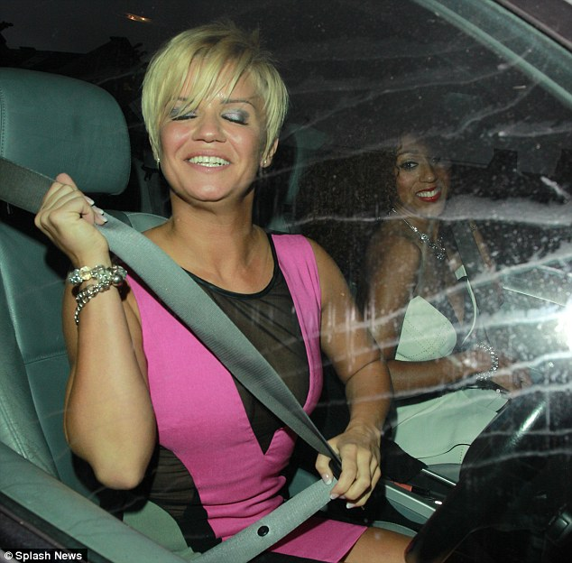 Buckle up: The reality star got the giggles as she chauffeured Danielle Brown home from the bash