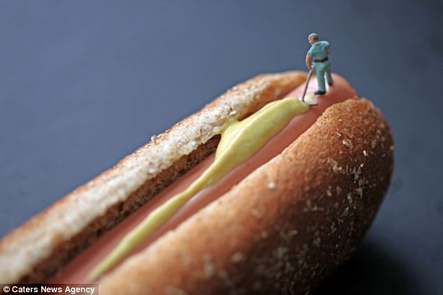 What a job! A man wipes mustard off a hot dog in another of Mr Boffoli's exquisite pieces