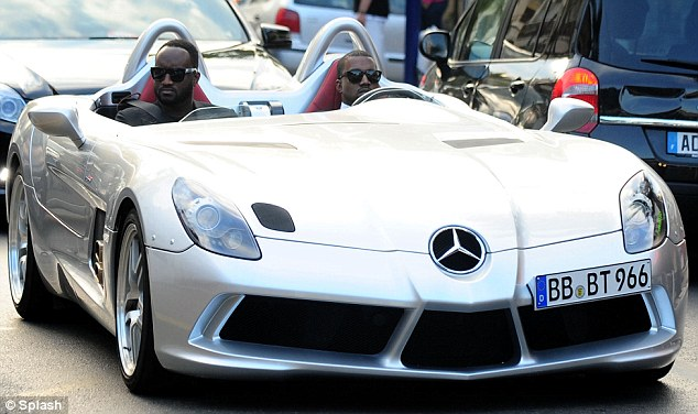 Nice wheels: Kanye West and a friend made their way to the annual amfAR dinner and auction today in a Mercedes concept car worth over $1.7m
