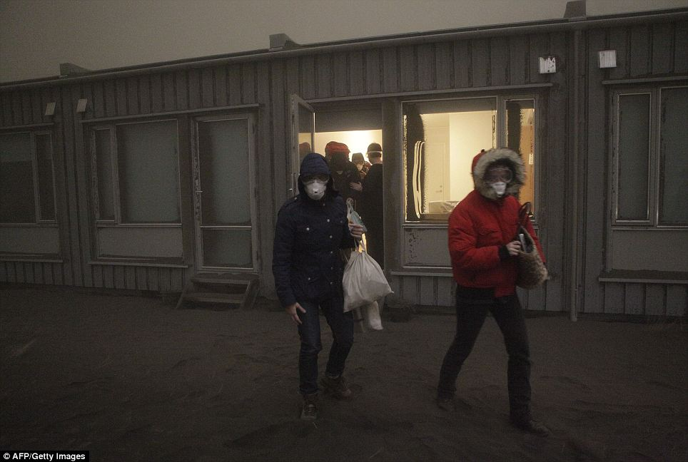 How are we going to get home? Tourists leave the Islandia Hotel yesterday in Nupur as ash continue to pour out of the erupting volcano