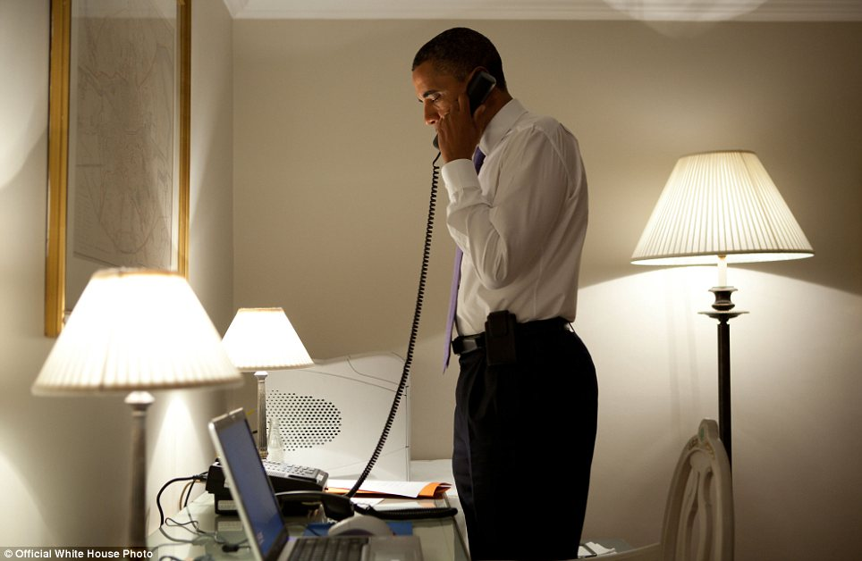 Condolences: President Barack Obama talks on the phone with Missouri Governor Jay Nixon during his visit to Dublin, Ireland. The President extended his condolences to all impacted by the deadly tornadoes