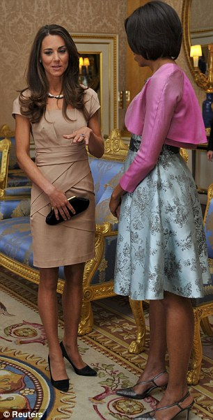 Radiant: Catherine wore a £175 Reiss 'Shola' dress in camel while Michelle opted for mint floral
