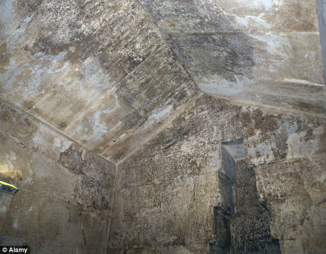 Inside the chamber: The limestone ceiling of the Queens Chamber inside the Great Pyramid can be seen, but what lies beyond has puzzled Egyptologists