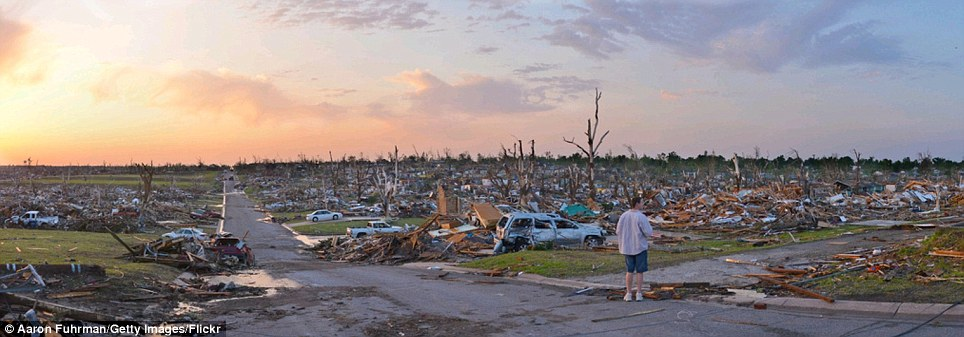 The aftermath: A 198mph tornado tore a path a mile wide and six miles long straight through Joplin, Missouri devastating all in its wake