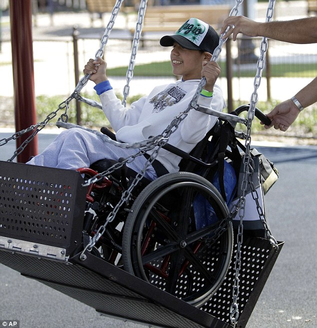 Refugio Valls enjoys a wheelchair swing, one of 20 attractions at the park. Many are specially designed to allow two wheelchairs to ride side-by-side