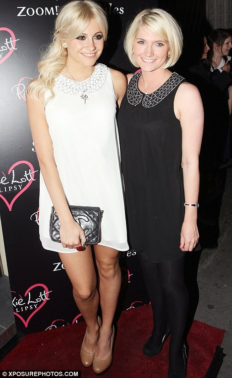 Family resemblance: Pixie posed up outside the event with her sister, who was wearing the black version of her white dress