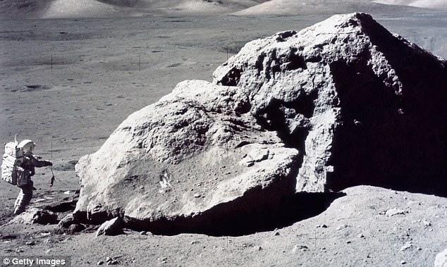 Return: Astronauts would be required to get the work under way. Pictured is American Harrison Hagan Schmitt on the moon in 1972