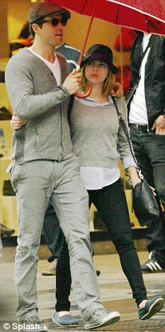 As they were: Ryan pictured last August with ex-wife Scarlett Johansson