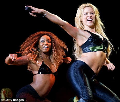 On tour: Shakira went through a number of costume changes during the show which is part of her Sale el sol (The Sun Is Coming Out) tour