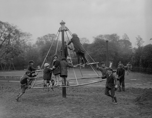 Magic memories: Children pile onto the primitive Witch's Hat ride. Few got off without a couple of knocks and bruises