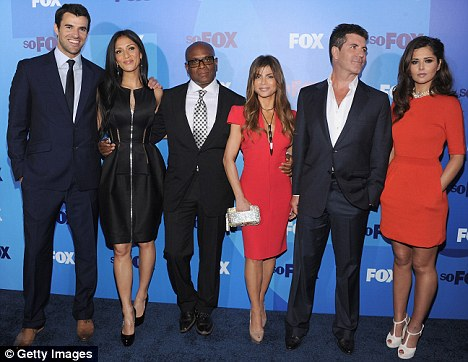 Back in the line-up? Cole with X Factor USA judges Antonio 'L.A.' Reid, Paula Abdul and Cowell and co-hosts Steve Jones and Nicole Scherzinger
