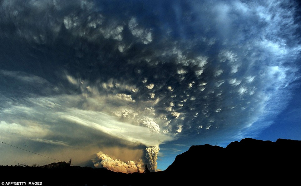 An extraordinary cloud formation is created by the ash rising several miles into the atmosphere