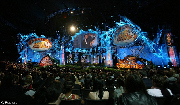 Packed to the rafters: Host Jason Sudeikis stands on stage as he does a monologue to open the 2011 MTV Movie Awards in Los Angeles