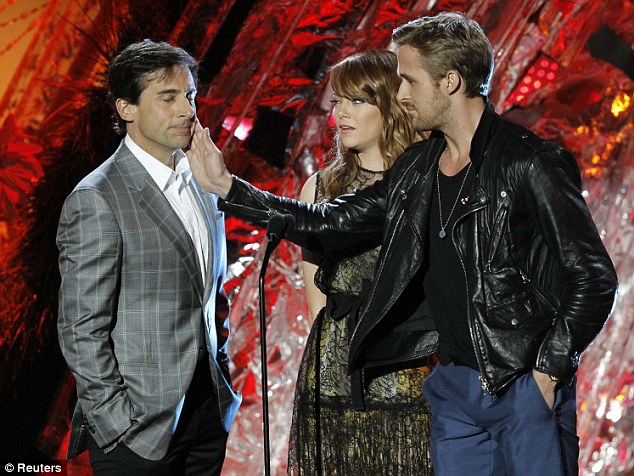 Pranks: Presenters Ryan Gosling slapped Steve Carrell as Easy A actress looked on as the trio presented an award