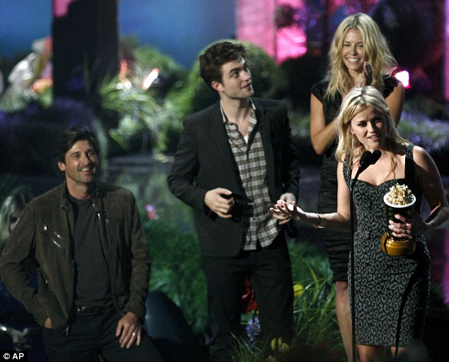 Turning the air blue: Reese Witherspoon accepts the MTV generation award as, from left, Patrick Dempsey, Robert Pattinson, and Chelsea Handler look on
