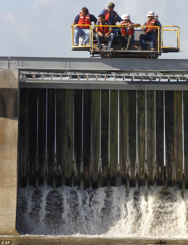 Hope: Engineers close the final bays of the Bonnet Carre Spillway just above New Orleans