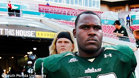 Strength: American footballer Danous Estenor, 21, a 6ft 3in 295lbs offensive guard, lifted a car and tow truck driver Pedro Arzola was pulled to safety