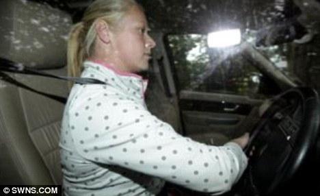 Driving home: Andrew Bridgen's wife Jacqueline behind the wheel of her car