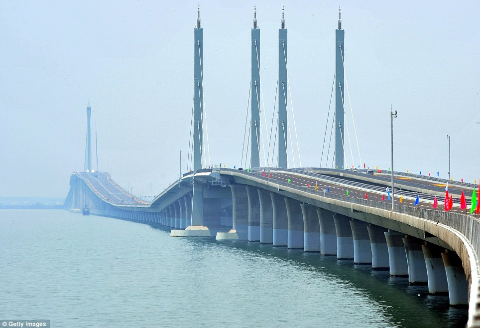 Record breaker: The Qingdao Jiaozhou bay bridge, spanning 26.4 miles between Qingdao and Huangdao, will open for traffic today