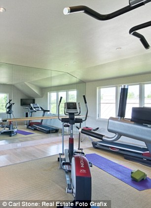 Eat in, work out: The house also comes with a home gym and lavish kitchen. Should Beck fancy a stroll to mull on his various philosophies he can do so within the sprawling grounds