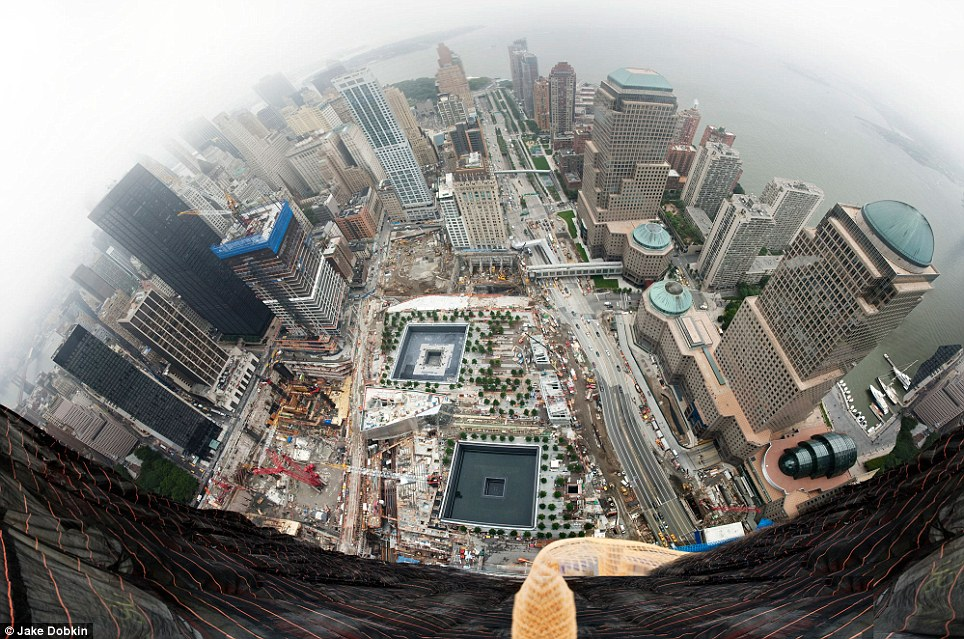Standing tall: A view from the top of One World Trade Center looking south as it rises 70 stories above Ground Zero. It will stand at 1,776ft as the city's tallest building