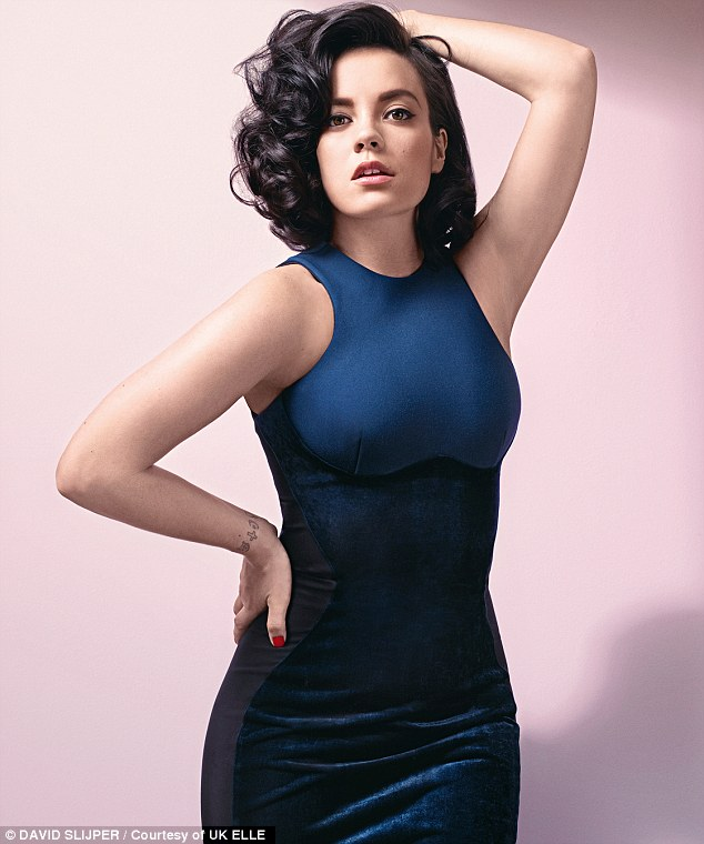 Beauty in blue: Lily then changed into a skin tight navy blue gown and posed with her hair short and curled for the Elle shoot