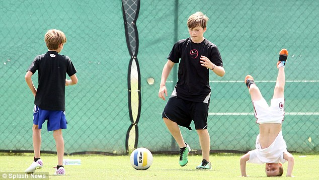 Growing brood: The footballer's three sons, Brooklyn, Romeo and Cruz, accompanied him at training