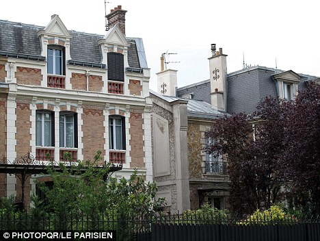 Bizarre: Laurence Honore, 42, admits stalking her husband, dressing up as Catwoman and hiding in bushes with a gun outside their home in Valenton, France