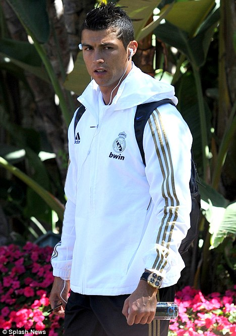 International jetset: Cristiano Ronaldo is pictured heading into training in Los Angeles with his multi time zone Quattro Valvole watch on