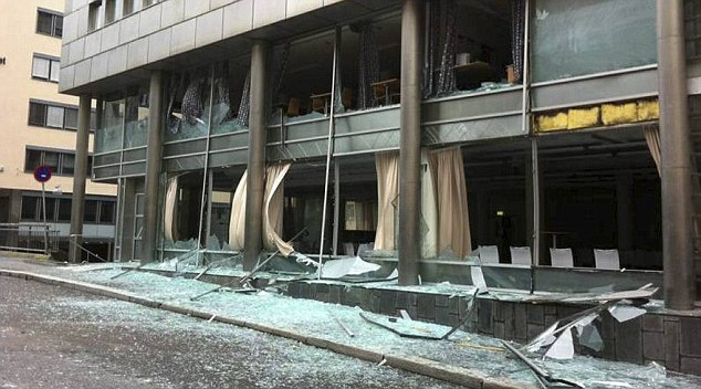 Shards of glass lay strewn on the pavement following the blast. It is not known how many people are injured