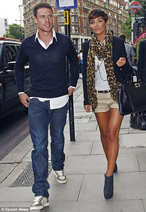 Bronzed: Frankie Sandford showed off her endlessly long legs in a pair of beige shorts as she stepped out with boyfriend Wayne Bridge in London today