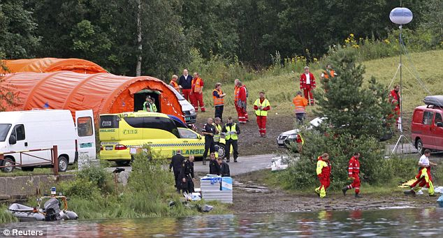 Rescue workers set up a camp opposite the island where the attack took place. A youth summer camp was underway when the gunman attacked