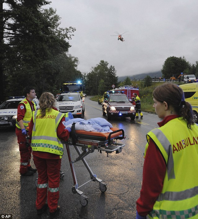Emergency: A helicopter hovers above the rescue area preparing to take victims of the attack to hospital