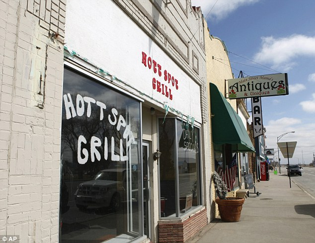 Deserted: The closed Hott Spot Grill, along with a couple of other businesses that remain on Main Street is seen in the centre of Hugo, Colorado