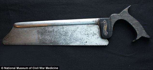 Heavy duty: After skin and muscle had been were severed, this amputation saw - made with a steel blade and an ebony wooden handle - cut through bones