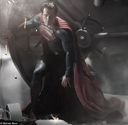 Man in tights: Henry Cavill sports an updated blue suit, bed boots and cape for the role of Superman in the rebooted new film Man of Steel, which will be released in cinemas in 2013