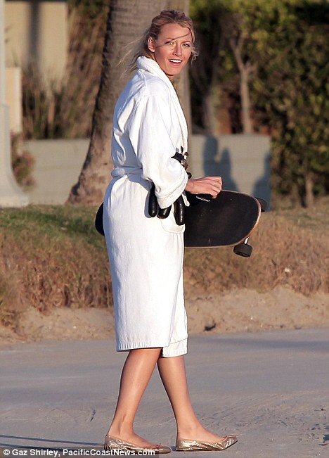 Boarding Blake: Ms Lively was spotted on the Gossip Girl set wearing a white robe and carrying a skateboard yesterday
